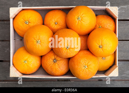 Wooden box of fresh oranges - Stock Photo