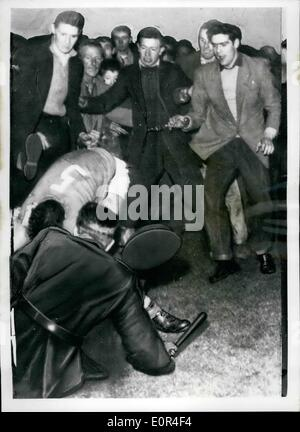 Dec. 12, 1957 - Italian players attacked after Northern Ireland v. Italy match at Belfast: At the end of yesterday's - Stock Photo