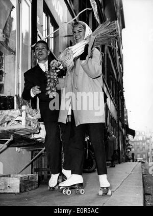 Actors Genevieve Cluny and Albert Pierjac skating - Stock Photo