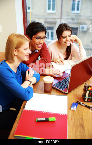Happy Group Of Young Students Studying Together - Stock Photo