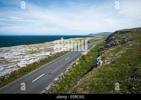 Road and Touring Route though the Burren in County Clare along the Wild Atlantic Way on the West Coast of Ireland - Stock Photo