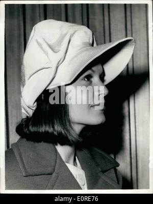Apr. 04, 1959 - Eva Barton Flies in. Wearing A Yellow Peaked Cap. Eva Barton, who is to star with Richard Attenborough, - Stock Photo