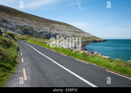 Coastal road in the Burren, County Clare, on the West Coast of Ireland - Stock Photo