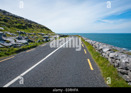 Blue Sky and Sea along Road and Touring Route in County Clare on the Wild Atlantic Way on the West Coast of Ireland - Stock Photo