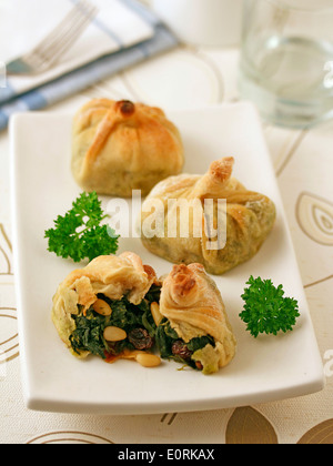 Bags of spinach. Recipe available. - Stock Photo