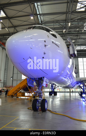 Nose of an Airbus A350XWB at the Airbus headquarters in Finkenwerder, Hamburg, Germany - Stock Photo