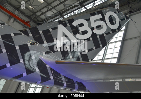 Tailfin of an Airbus A350XWB at the Airbus headquarters in Finkenwerder, Hamburg, Germany - Stock Photo