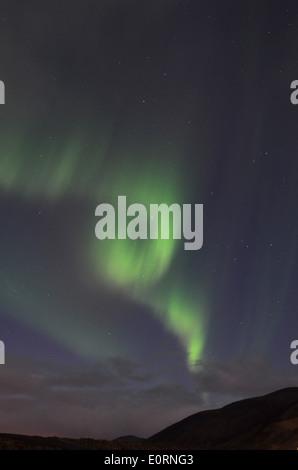 Aurora Borealis or Northern Lights above the Northern Lights Inn, near Grindavik, iceland - Stock Photo