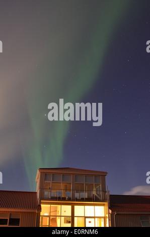 Aurora above the Northern Lights Inn, near Grindavik, iceland - Stock Photo