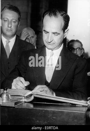 Jose Figueres Ferrer signing a book - Stock Photo