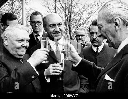 Ludwig Erhard toasting with others - Stock Photo