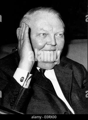Ludwig Erhard covering part of his face - Stock Photo
