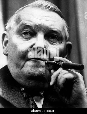 Ludwig Erhard smoking a cigar - Stock Photo