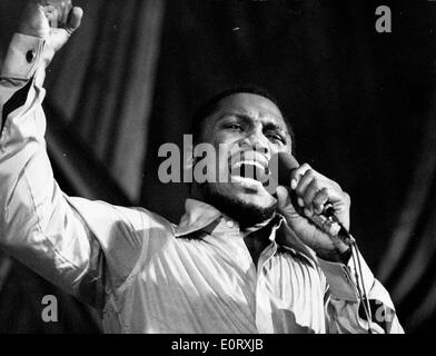 Boxer Smokin' Joe Frazier on stage singing - Stock Photo