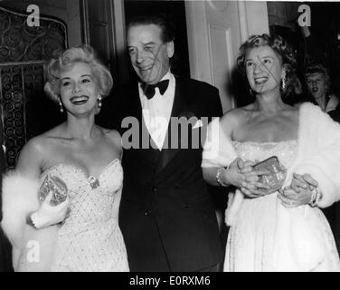 Actress Zsa Zsa Gabor arrives at a party with friends - Stock Photo