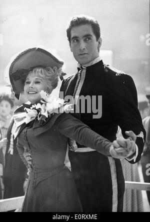 Actress Zsa Zsa Gabor dances with man at party - Stock Photo