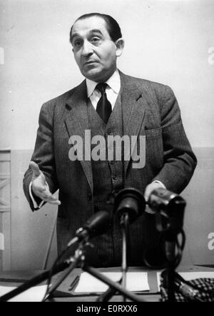 French politician PIERRE MENDES FRANCE talks into microphones. - Stock Photo