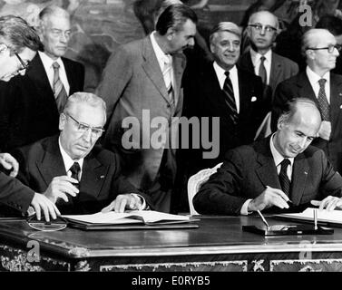 Politician Edward Gierek signs documents - Stock Photo