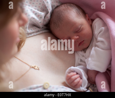 Mutter haelt ihr Baby im Arm - mother holds her baby in her arms - Stock Photo