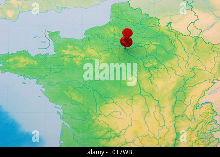 Red pushpin on Paris city, map of France - Stock Photo