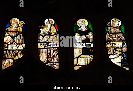 Medieval stained glass window, St. Erasmus, Bishop of Formia, St. Agnes, St. Stephen, Sandringham Parish Church, - Stock Photo