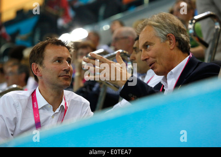 Britain's new Health Secretary Jeremy Hunt (L) and Former Prime Minister, Tony Blair (R) attend the swimming session - Stock Photo