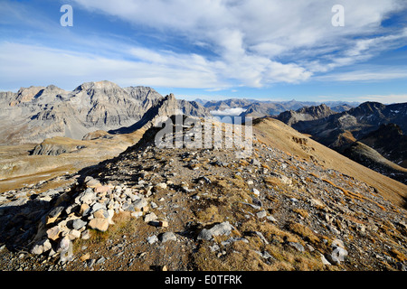 Mountain footpath leading up to the top of M. Thabor (3178 m) in afternoon light on barren terrain. - Stock Photo