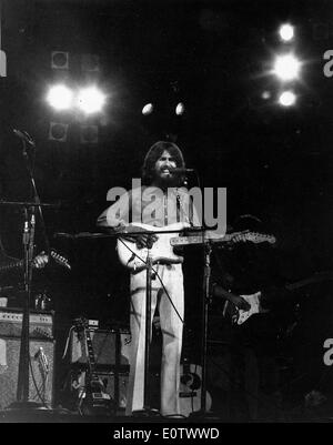 Beatle George Harrison performs in concert - Stock Photo