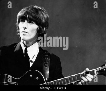 Beatle George Harrison performs at concert - Stock Photo