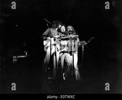 Beatle George Harrison performs with other band - Stock Photo
