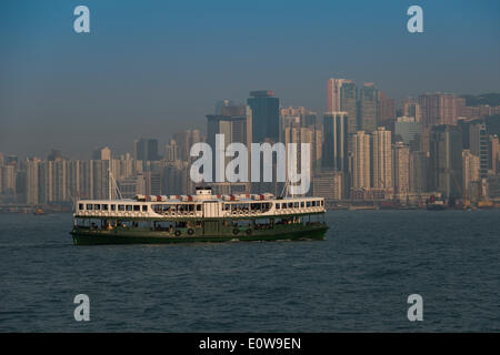 Ferry from Kowloon, Star Ferry, in front of the skyline of Hong Kong Island, Hong Kong, China - Stock Photo