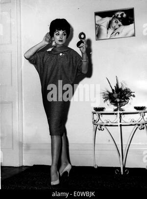 Actress Joan Collins looking in a mirror - Stock Photo