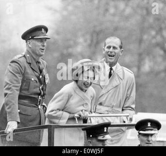 Queen Elizabeth II and her husband Prince Philip watching a presentation - Stock Photo