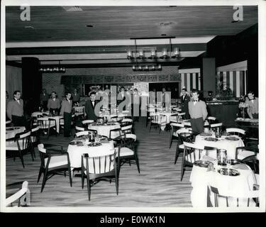 Apr. 04, 1963 - Situated on the ground floor of the London Hilton, the London Tavern restaurant accommodates 100. The decor blends dark stained wood, London brick, plaster, copper, wrought iron and steel in wall and ceiling treatments with colourful carpets and furnishings. A patterned bright green carpet suggests the green of the English countryside. Decorative chandeliers are made of black ironwork and glass, and patterned copper hood covers the grill in the background.