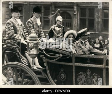 May 05, 1963 - Belgian Royal visits: Queen Elizabeth wves. King Baudouin and Queen Fabiola of the Belgians arrived at Victoria this morning for their State visit. Photo shows the Queen as she rides in the landau with King Baudouin.