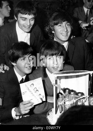 The Beatles holding a cake they received at Hotel Royal - Stock Photo