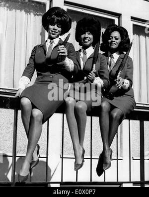 The Supremes sitting on a fence on their first visit to London - Stock Photo