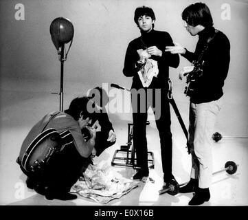 The Beatles snack while breaking from filming - Stock Photo