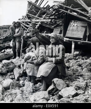 FILE PHOTO - Apr. 7, 1965 - Peloponnisos, Greece - A family sits desolate amidst the ruins of their home in the - Stock Photo