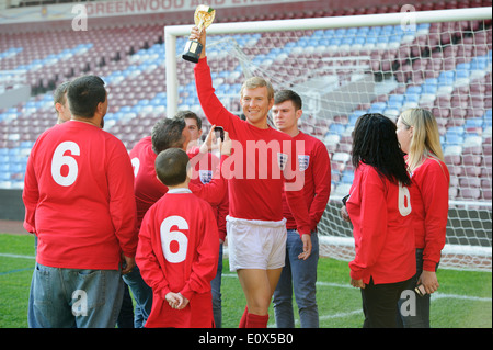 The Bobby Moore wax figure is unveiled at West Ham United football stadium - Stock Photo