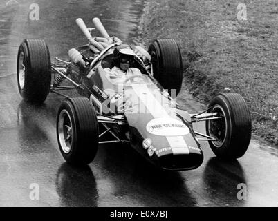 British Formula One racing driver JIM 'Jimmy' CLARK drives a Lotus Ford in the Swiss Mountain Grand Prix in Ollon - Stock Photo