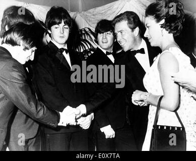 The Beatles meeting Lord and Countess Snowdon at the 'Help' premiere - Stock Photo