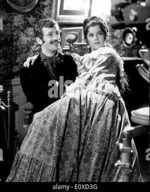 Jean-Paul Belmondo and Genevieve Bujold in a scene from 'Le Voleur' - Stock Photo