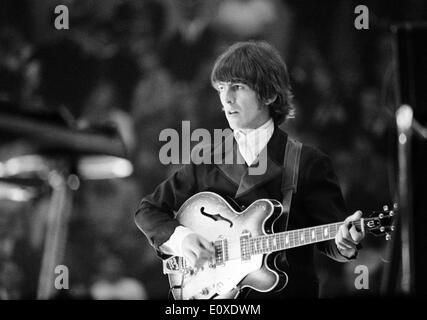 The Beatles' George Harrison pictured during a concert in Germany - Stock Photo