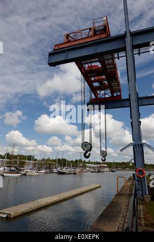 old industrial cranes in edward albert dock in Riversway Preston docklands marina England UK - Stock Photo