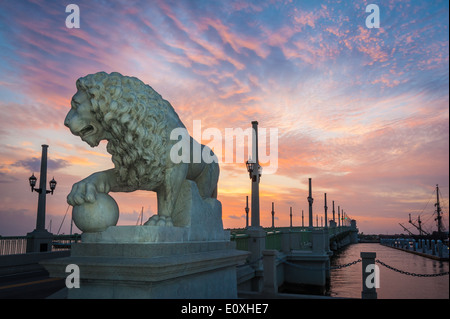 Sunrise paints the sky with color above the Bridge of Lions, a Florida landmark connecting St. Augustine to Anastasia - Stock Photo