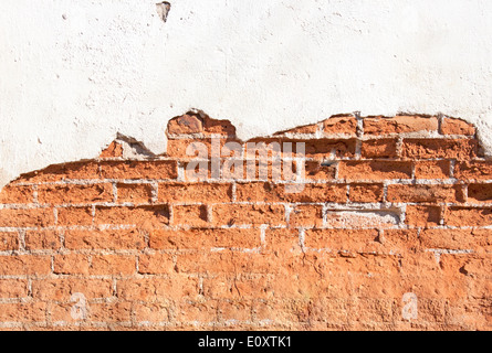 Old brick wall of red brick weathering weathered. - Stock Photo