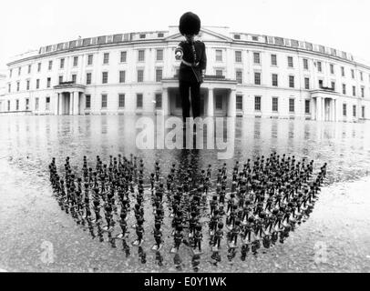 Guard with toy soldiers in front of palace - Stock Photo