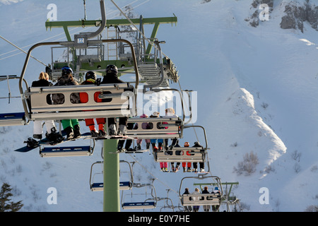 Row of chairlifts. Le Mont Dore ski resort. Auvergne. France - Stock Photo