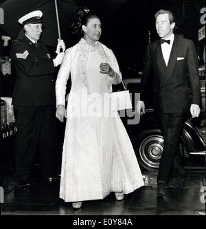 Apr. 15, 1969 - Royal Theatre Visit: Princess Margaret, Protected from heavy rain by a large umbrella, gallantly - Stock Photo